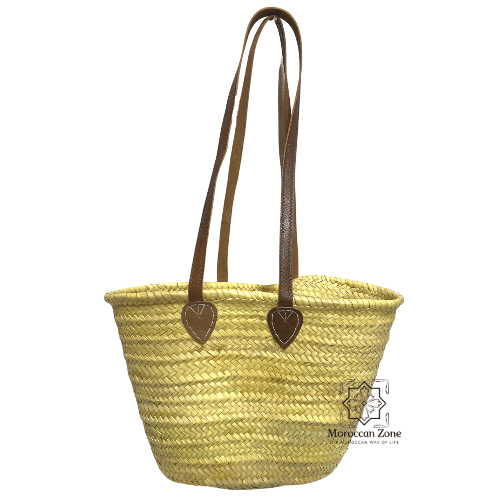 Straw basket with brown flat leather handles