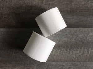 Two bamboo toilet tissue rolls
