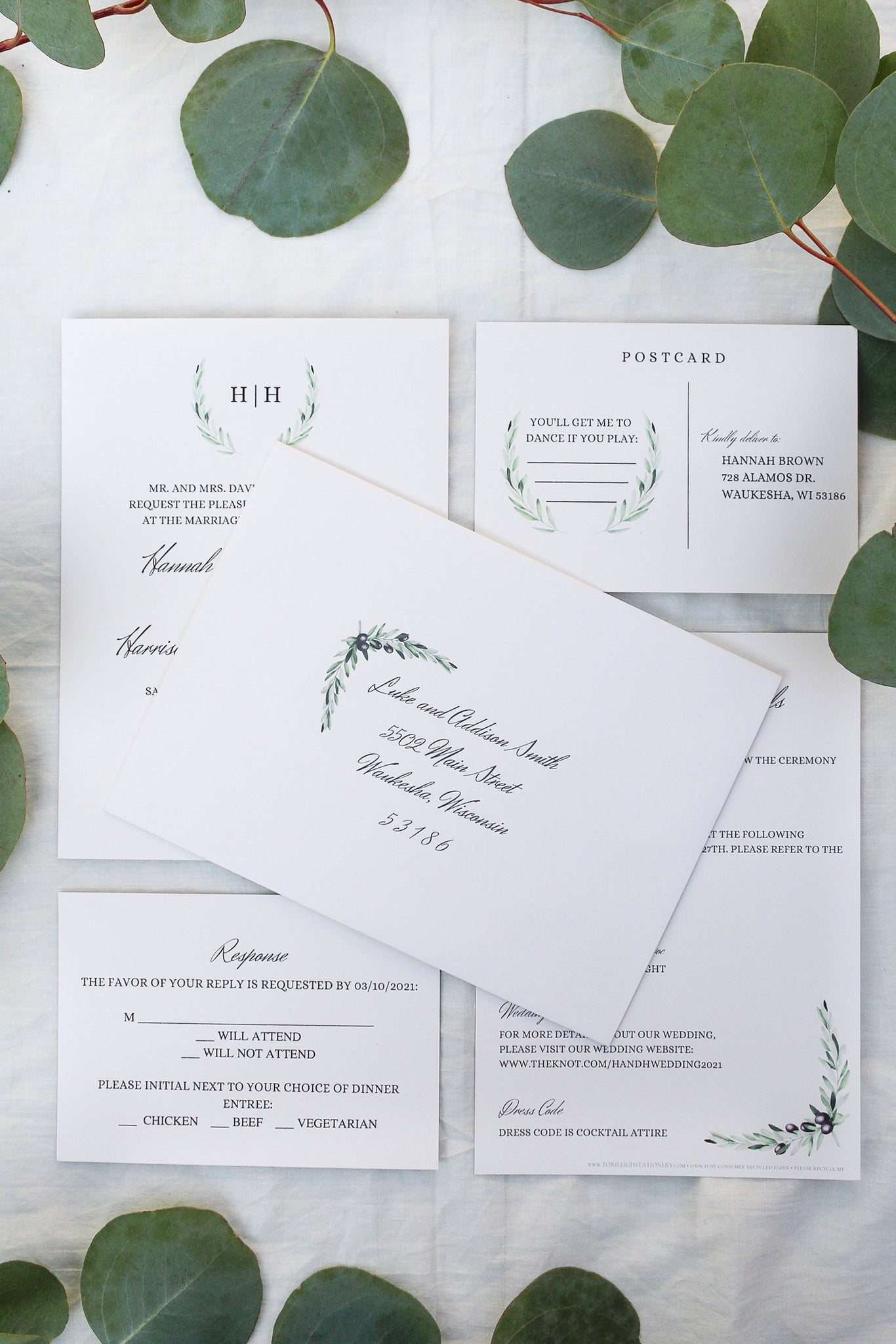 laurel wreath, olive branch, elegant calligraphy wedding invitations sustainably printed on 100% recycled paper envelope