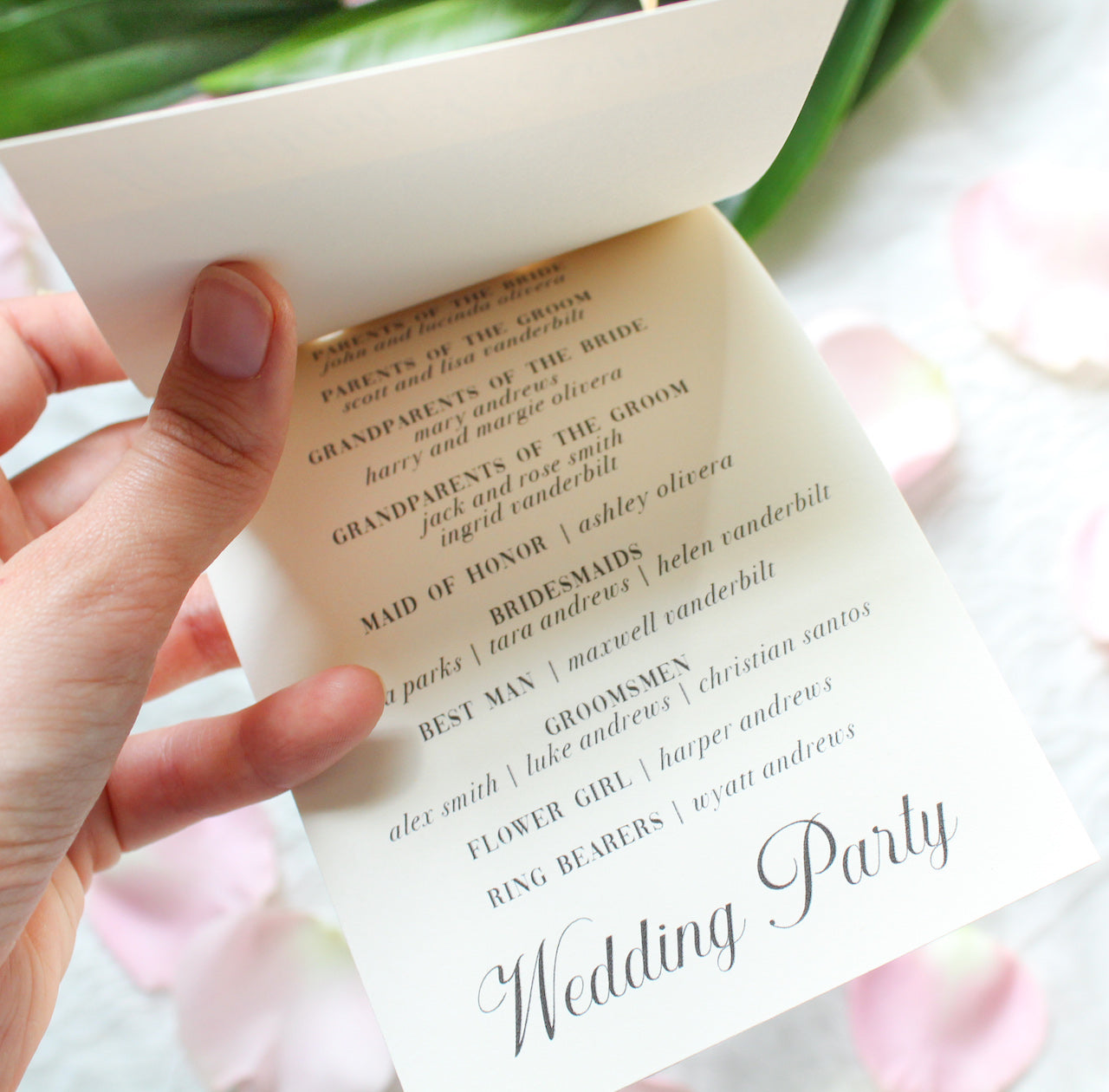 ribbon tied elegant calligraphy layered wedding invitations sustainably printed on 100% recycled paper