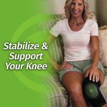 Load image into Gallery viewer, Woman smiling while sitting on couch wearing Knee Relief; text says stabilize & support your knee