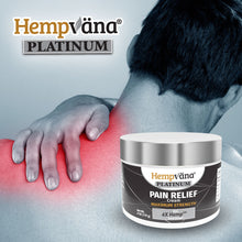 Load image into Gallery viewer, Man holding sore neck in background; jar of Hempvana Platinum Pain Relief Cream in foreground