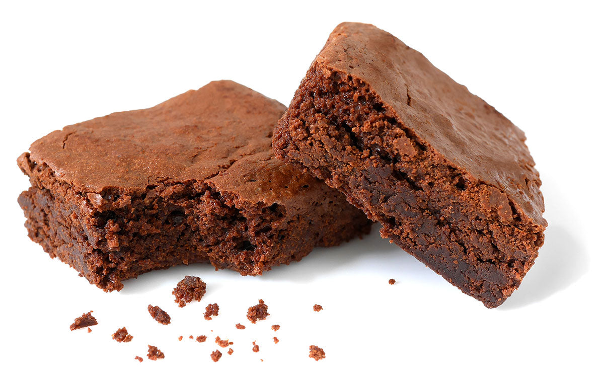 Two chocolate fudge brownies isolated on white background
