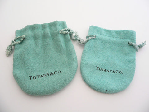 82a4ca541cf The bottom two are Real pouches. These are the newer version of Tiffany  pouches. Although all four pouches have the Tiffany & Co. logo ...