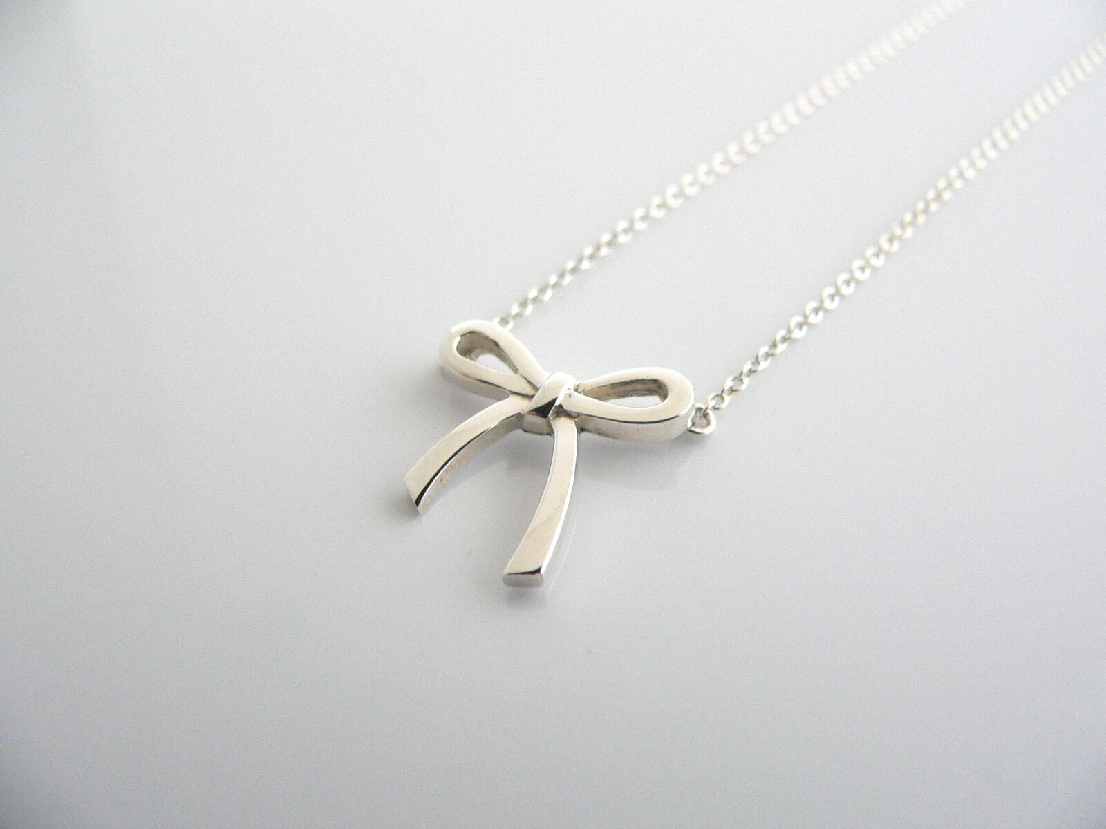Tiffany & Co  Silver Ribbon Bow Necklace Pendant Charm Chain Gift Love