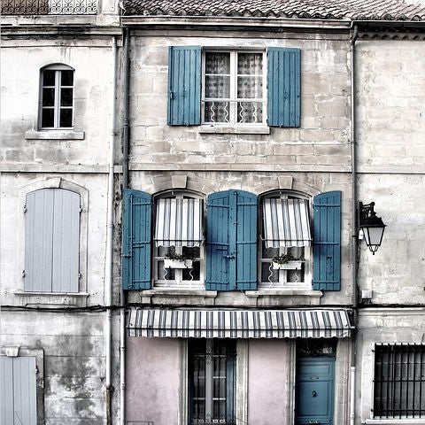 french country home with blue shutters