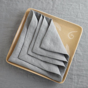 Tan Set of natural linen napkins with mitered hem