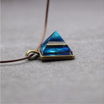 Glowing Pyramid Pendant with Blue Crystal – Add Some Shine and Color To Your Collection