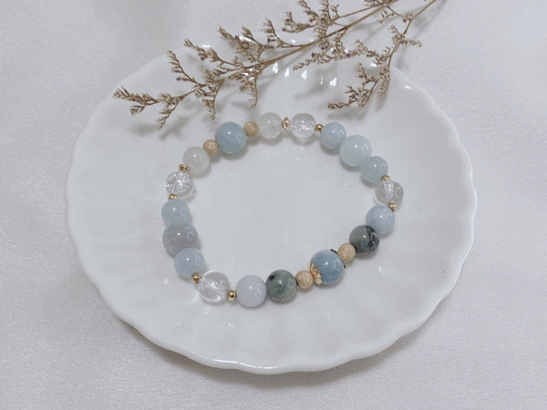 Aquamarine, Blue Quartz, Clear Quartz, Jadeite, Moonstone, Gold Hardware