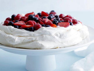 Pavlova is a meringue based dessert that is crispy on the outside and soft on the inside.