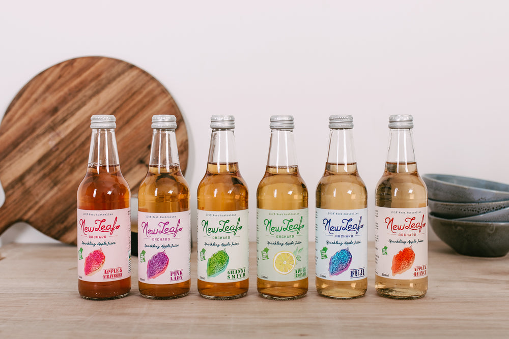NewLeaf Orchard sparkling juices lined up in a row