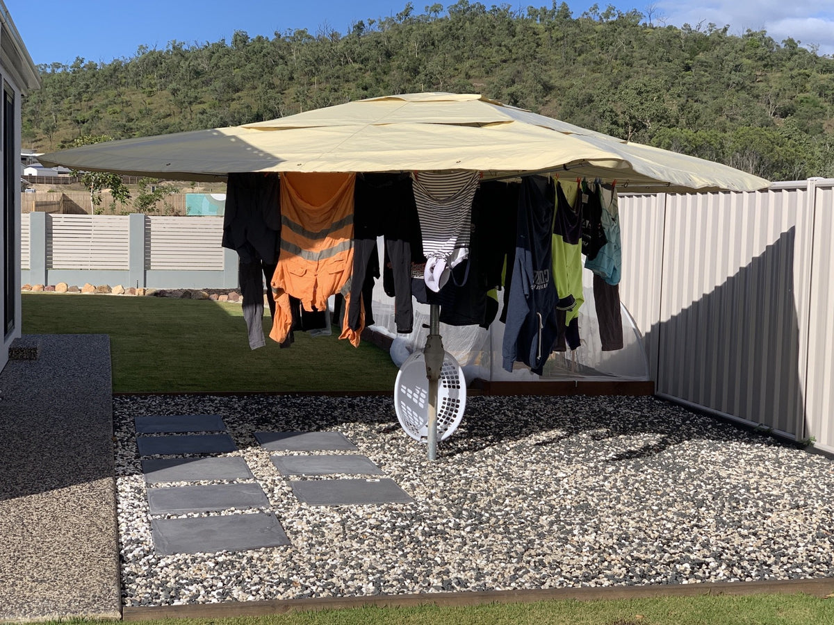 hills hoist clothesline with waterproof cover and washing hanging on the line