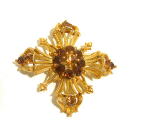 Topaz Hued Rhinestone Dotted Cross 1960s Pin