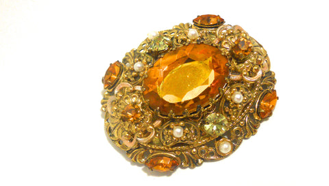 Filgree Goldtone Metal Brooch with Topaz Rhinestones circa 1960s