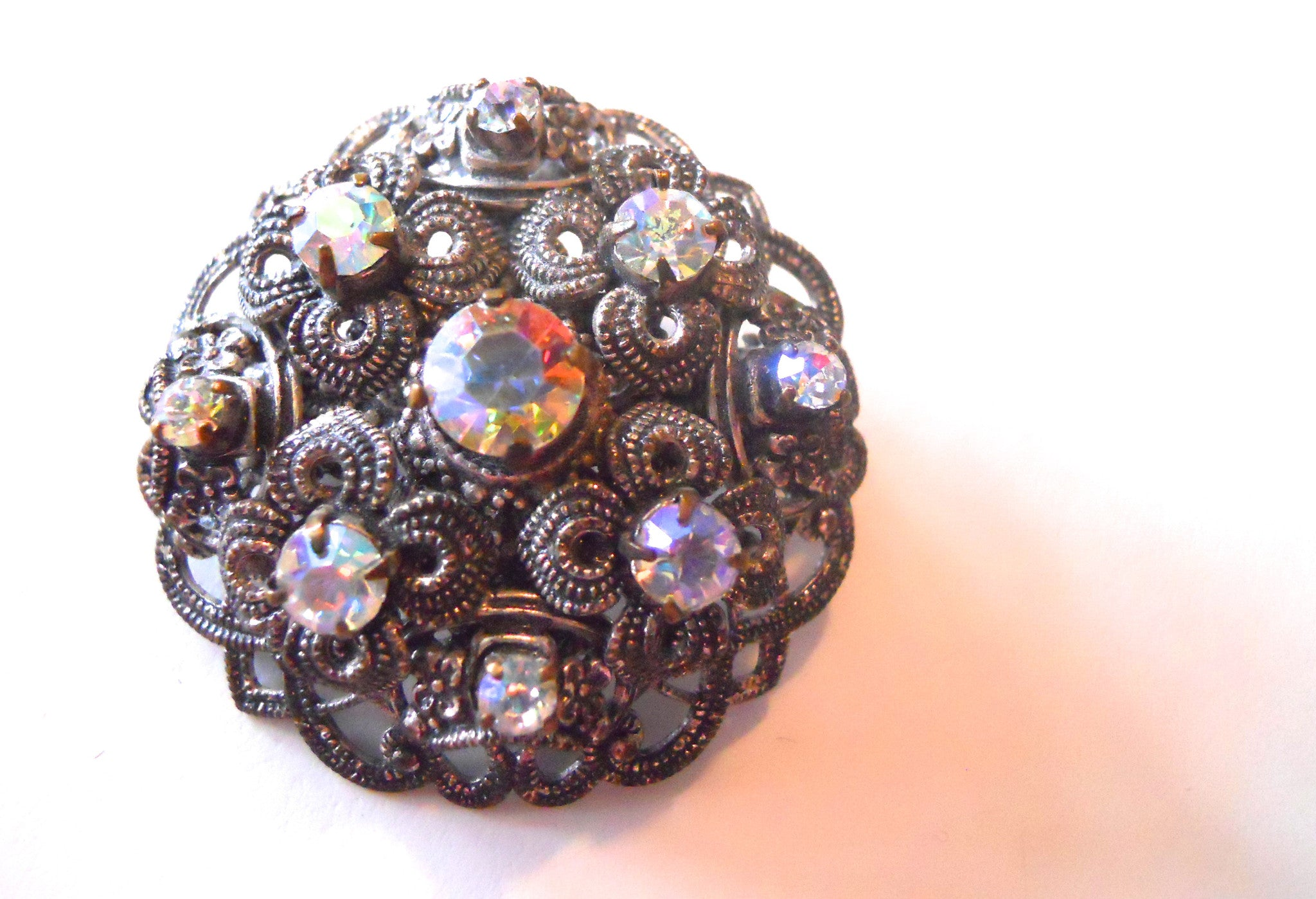 Iridescent Rhinestone Filigree Domed Brooch circa 1960s