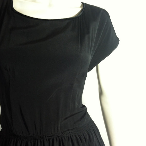 Flirty Black Rayon Full Skirt Party Dress w/ Shirred Waist and Velvet Trim circa 1950s