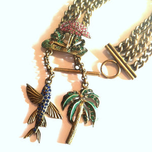 Magnificent Souvenir Charm Bracelet With Rhinestone Pink Flamingo Blue Flying Fish and Palm Tree circa 1940s
