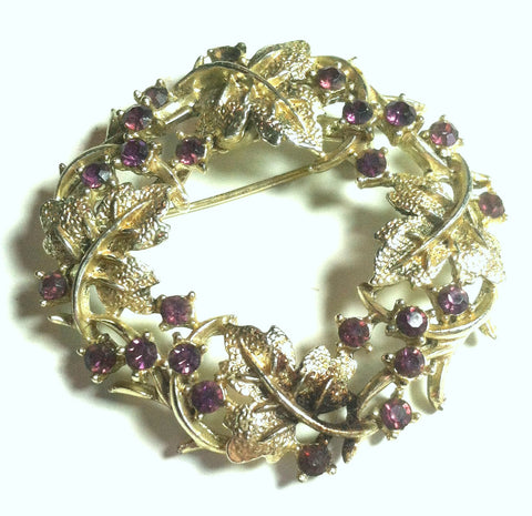 Goldtone Metal Wreath Brooch with Pink Rhinestones circa 1960s