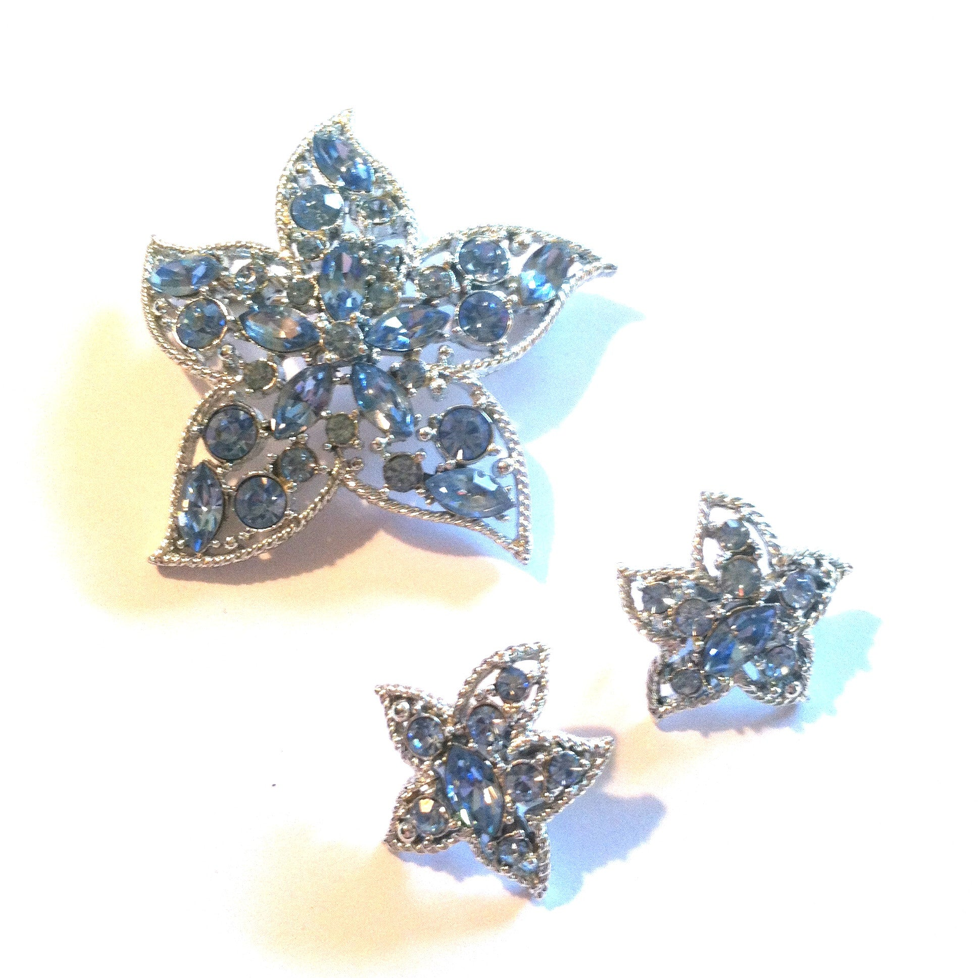 Star Fire Blue Rhinestone Brooch and Clip Earrings circa 1960s Dorothea's Closet Vintage Jewelry Sarah Coventry