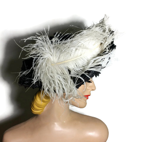 Wide Brim Black Raffia and Lace Woven Hat with Ostrich Plume circa Early 1900s