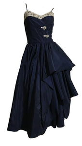 Rhinestone Button Trimmed Deep Blue Taffeta Cocktail Dress with Swagged Skirt circa 1940s
