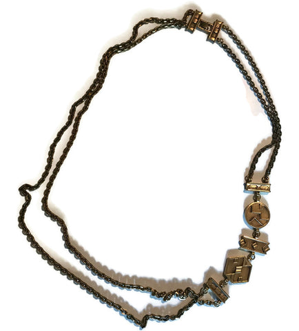 Striking Gold Tone Metal Double Chain Long Necklace with Abstract Side Links circa 1980s