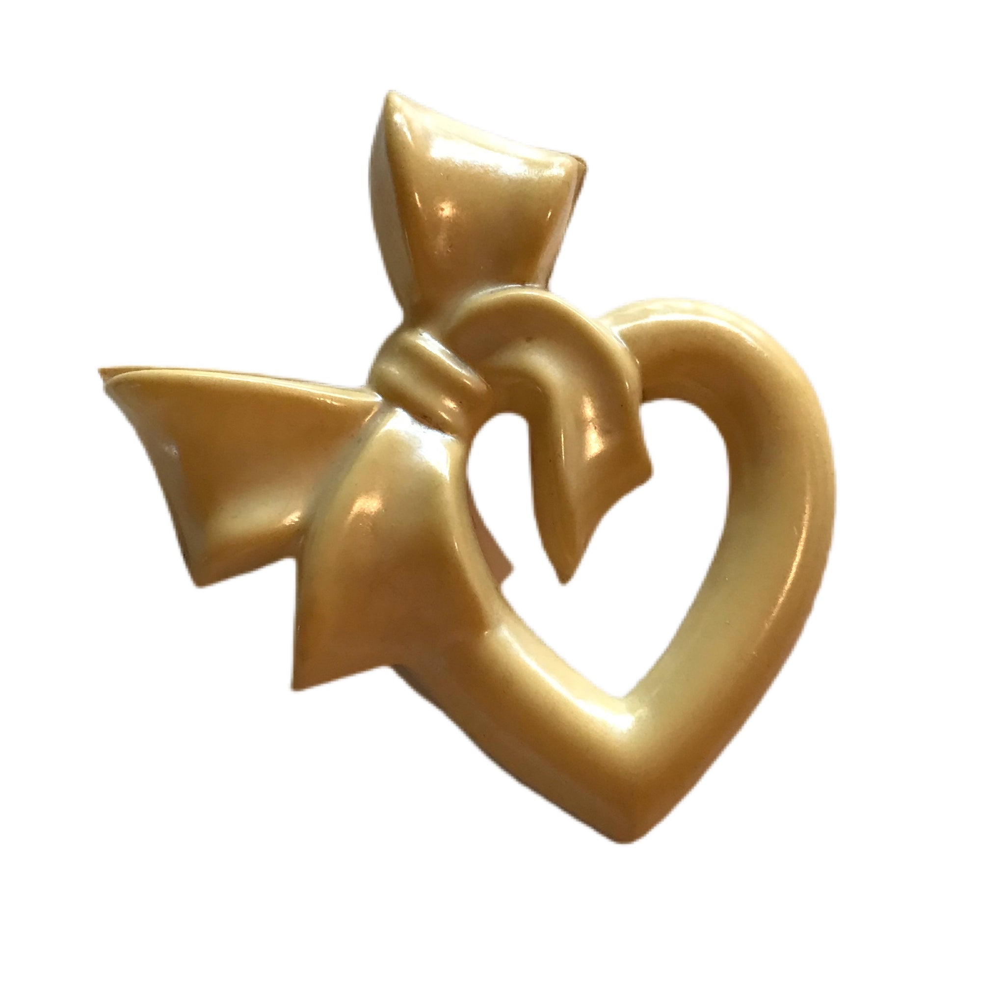 Ivory Celluloid Cartoon Heart and Bow Brooch circa 1930s