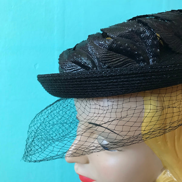 Black Narrow Brimmed Boater Style Hat with Flame Shaped Leaves on Open Top circa 1960s
