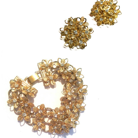 Sparkling Rhinestone Dotted Goldtone Metal Flower Bracelet and Clip Earrings circa 1950s
