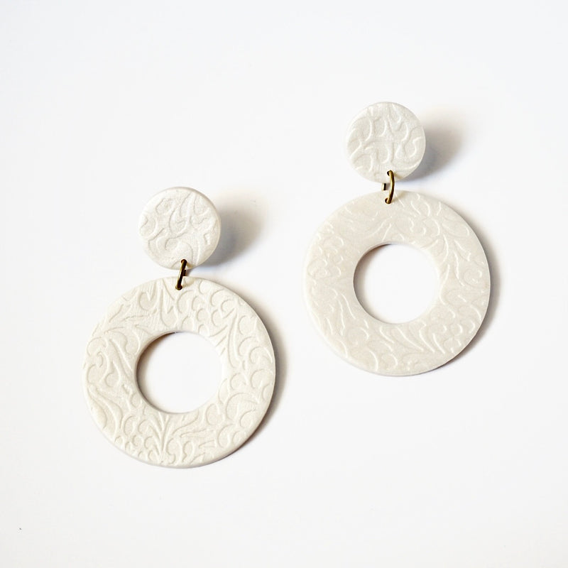Handmade pearl color polymer clay earrings & clay studs with flower print.