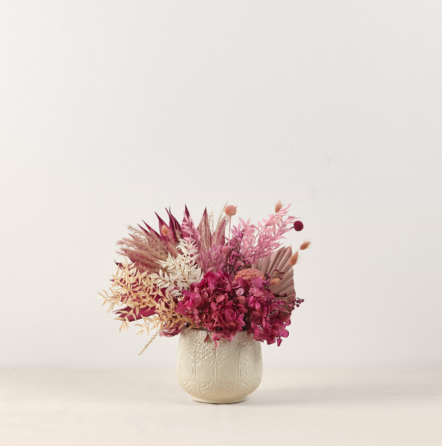 pink and purple dried vase arrangement