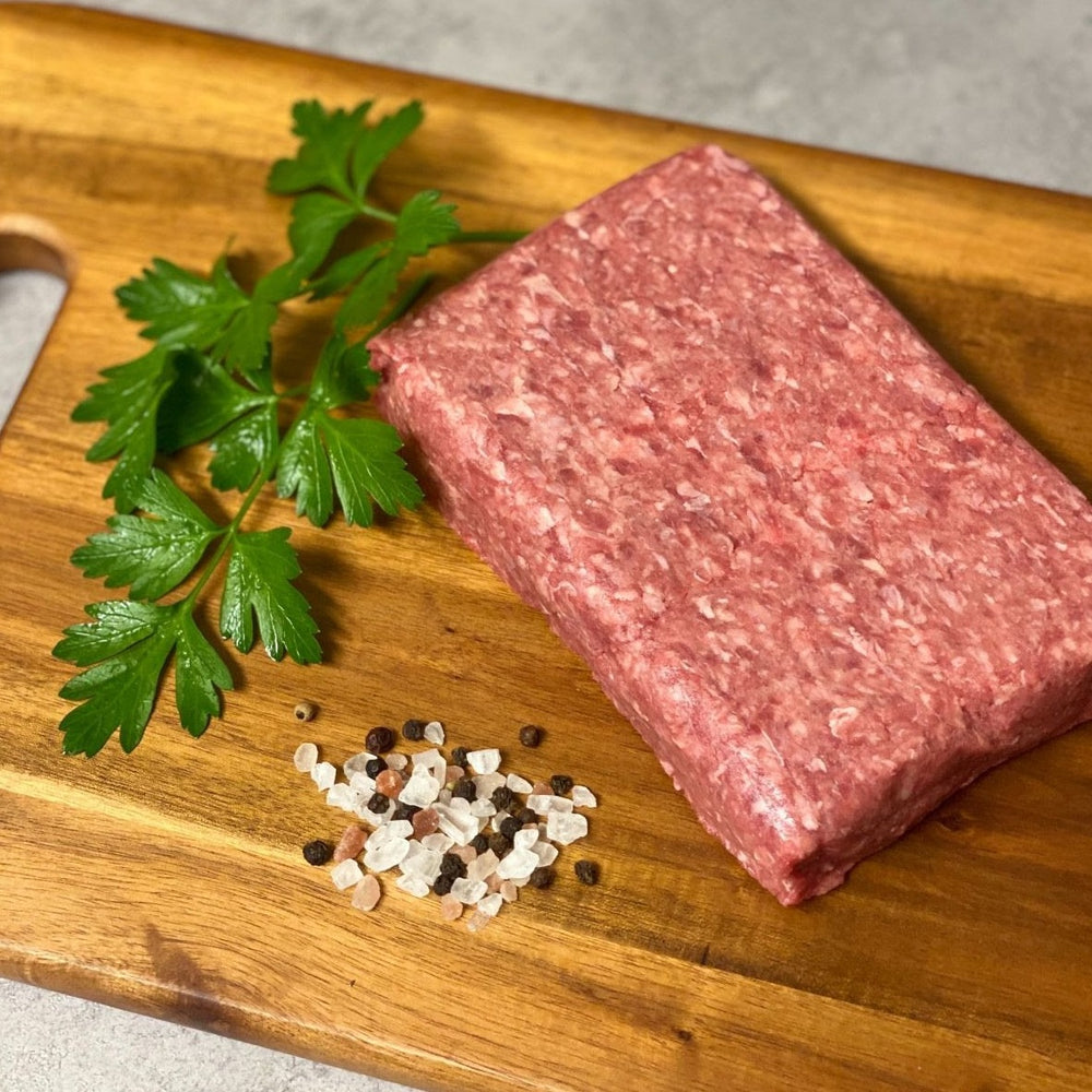 Grassfed ground beef on cutting board