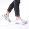 Men's KO-Z SPORT Low sheepskin lace up sneaker slipper white light grey on model wearing black denim cuffed jeans