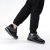 Women's KO-Z SPORT Low Wedge sheepskin lace up sneaker slipper black grey on model wearing cropped light blue joggers