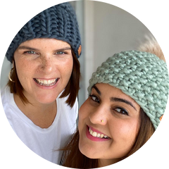 Cardi and Co owners, two girls, handknitted beanies