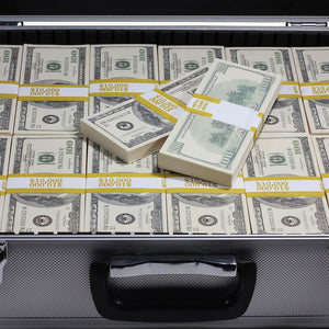 close up of 2000 series full print prop money stack inside silver metal briefcase