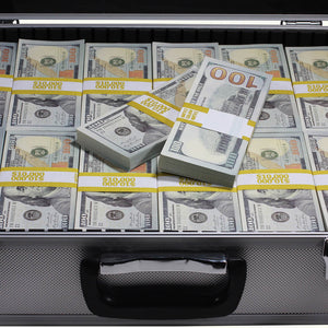 close up of new series 100 full print prop money stack in silver metal briefcase