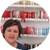 Ruth Caig with a display of ribbons