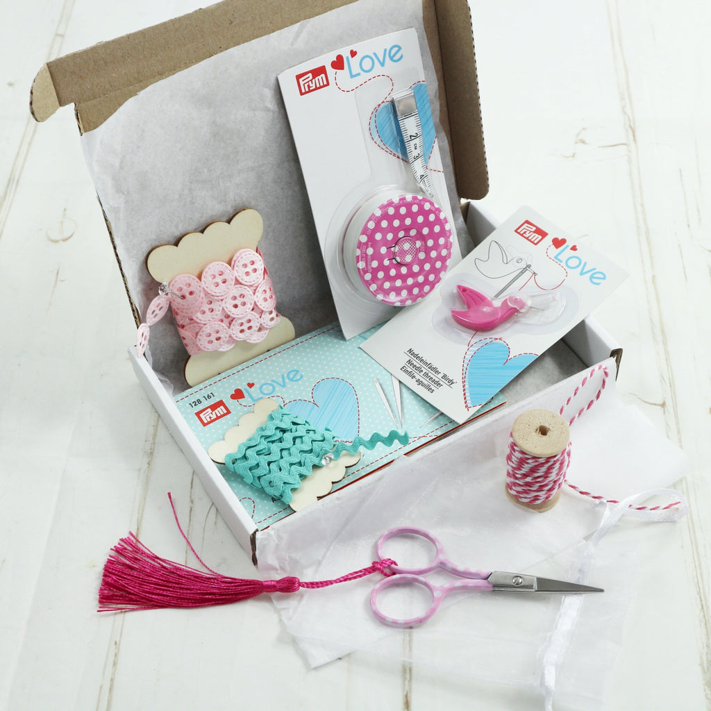 Pretty Gifts For Sewer. Tape measure, needle threader, needle book, embroidery scissors. Turquoise and pink polka dots.
