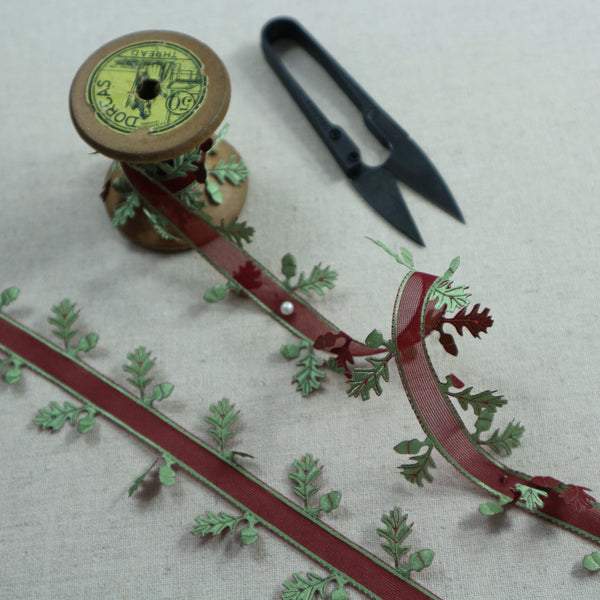 Oak leaf Christmas ribbon with red centre and satin green leaves.