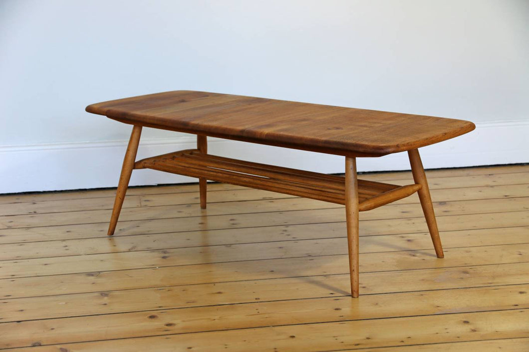 Mid Century Ercol Coffee Table with Magazine Rack, 1960s.