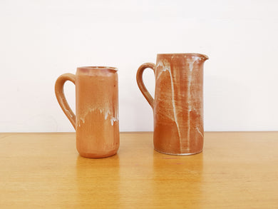 Pair of French Sandstone Pitchers