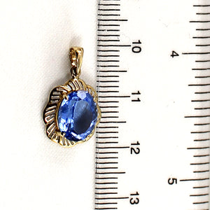 14k Solid Yellow Gold Features an 8x10mm Oval Cut Blue Topaz Pendant