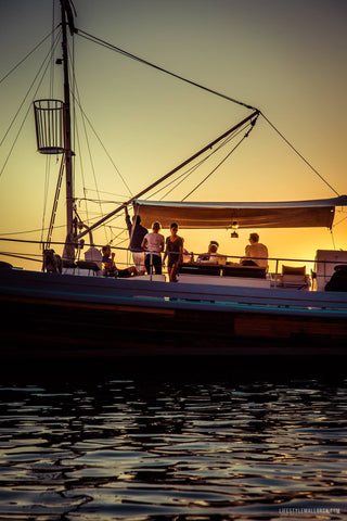 Sunset boat trip on Bonnie Lass Charters with executive team of charter guests aboard on holiday sunset charter.