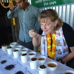 Tea Connoisseur and shop owner tasting white, green, and black teas in Kumaon India