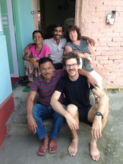 Indian and US friend sitting on step outside of house at Makaibari estate