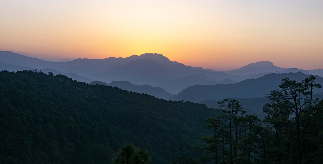 sunset over the Himalayan mountains in Kumaon, India