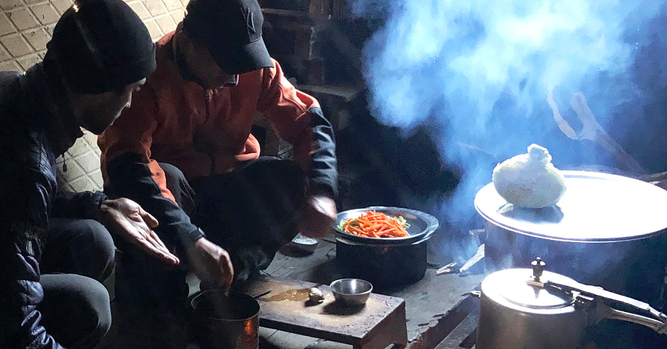 Raj and Passang making dinner in a tea hut while on a trek, Darjeeling, India
