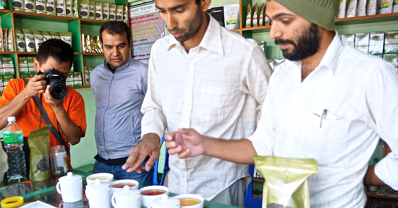 Our founder, Raj, cupping tea in Nepal