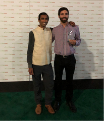 Lucas Ahlquist and Raj Vable receive the 2018 Tea Sustainability Initiative award on behalf of Young Mountain Tea